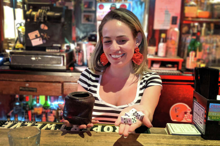 Black Magic Voodoo Lounge is the late-night dice destination for players after Black Horse London Pub closes at midnight. Bartender Lola Lugo-Gomez can tell a novice 1-4-24 player if they save a four on an early roll. Photo: Dan Gentile