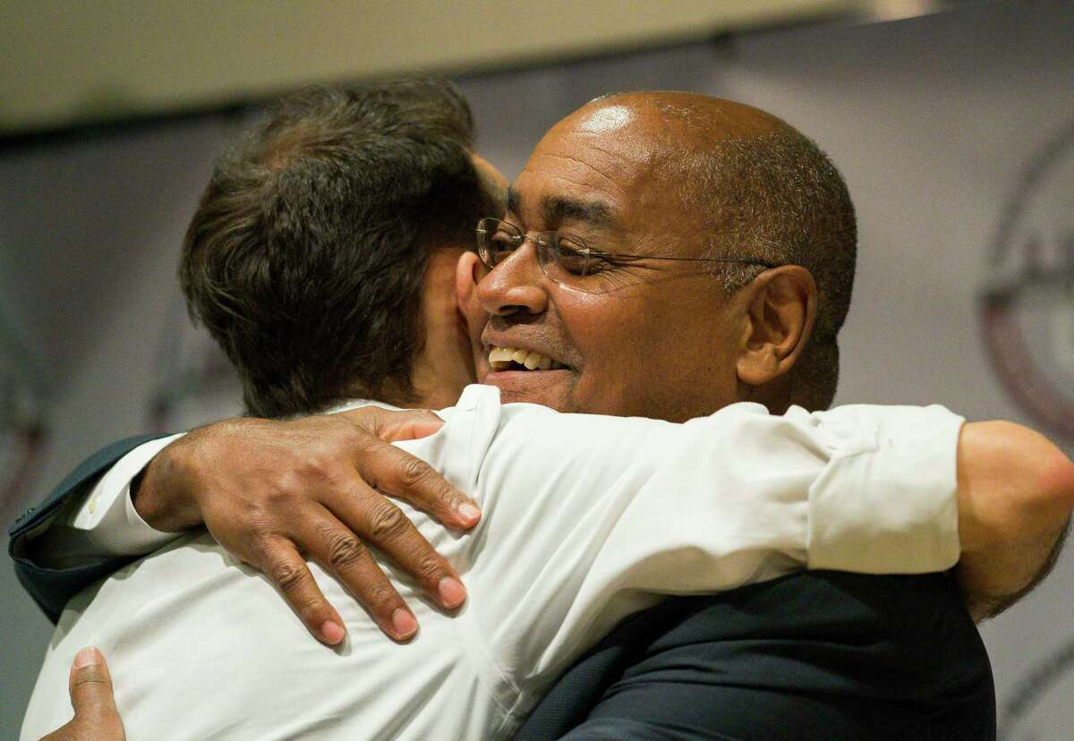 Harris County Commissioner Rodney Ellis embraces lawyer Alec Karakatsanis, who led a class-action lawsuit against the county on behalf of indigent defendants challenging the county's cash bond system, at Texas Southern University in Houston on Jan. 17, 2019. The new rule allowed qualifying misdemeanor defendants to be released on a personal bond rather than a cash bond.
