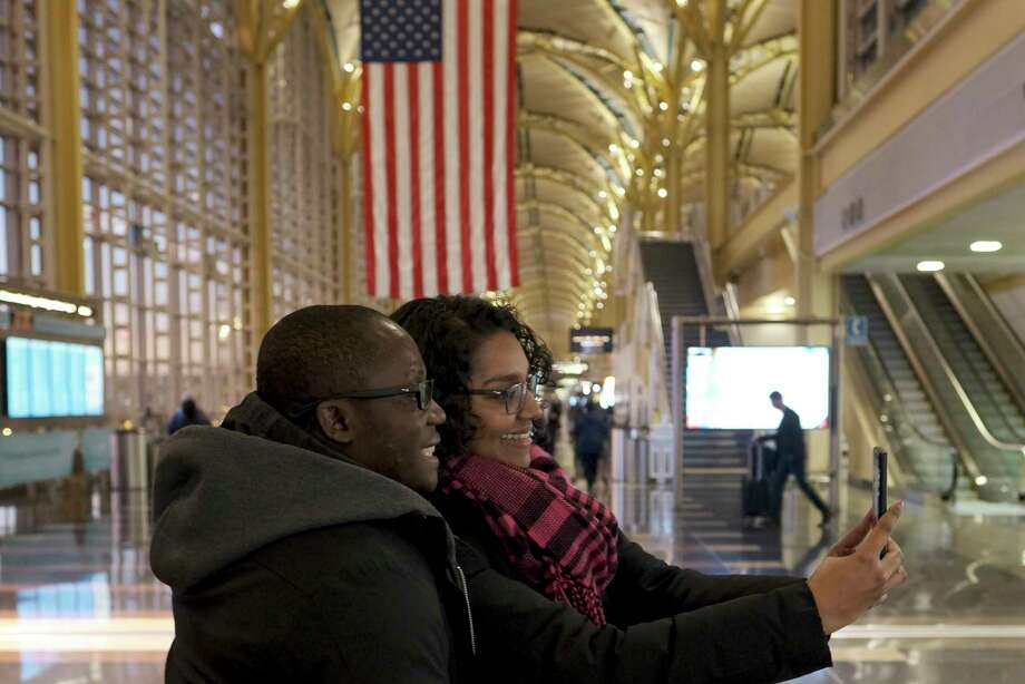 My Ford Noel and Sadhana Singh take a selfie at Reagan National Airport in in Virginia in February, 2019. Photo: Washington Post Photo By Bonnie Jo Mount / The Washington Post