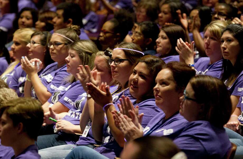 Teachers, faculty and staff listen as Leslie Milder with Friends of Texas Public Schools speaks during Willis convocation at Lynn Lucas Middle School, Wednesday, Aug. 16, 2017, in Willis. Photo: Jason Fochtman, Staff Photographer / Houston Chronicle / © 2017 Houston Chronicle