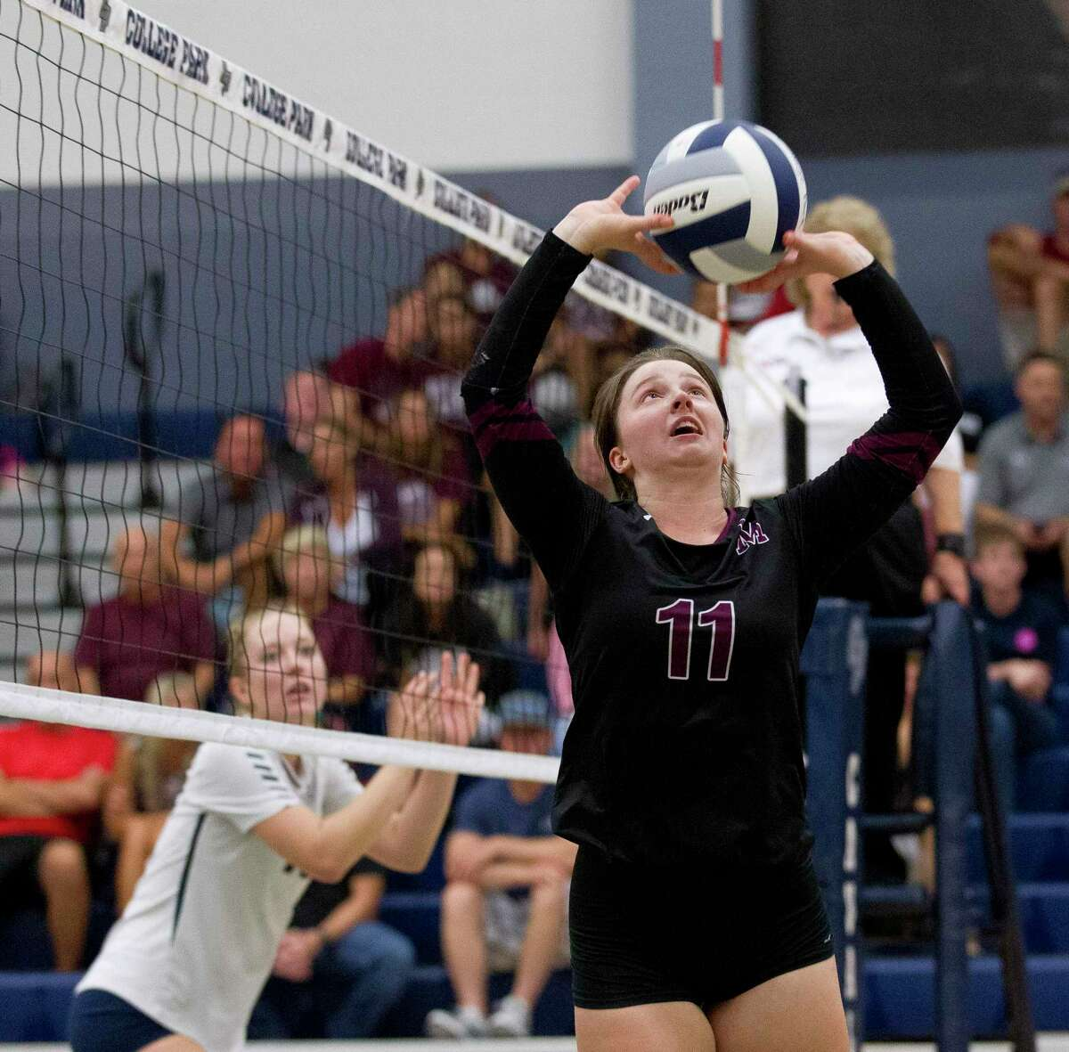 Magnolia's Faith Lynch (11) sets the ball during the second set of a non-district high school volleyball match at College Park High School on Saturday, Aug. 25, 2018, in The Woodlands