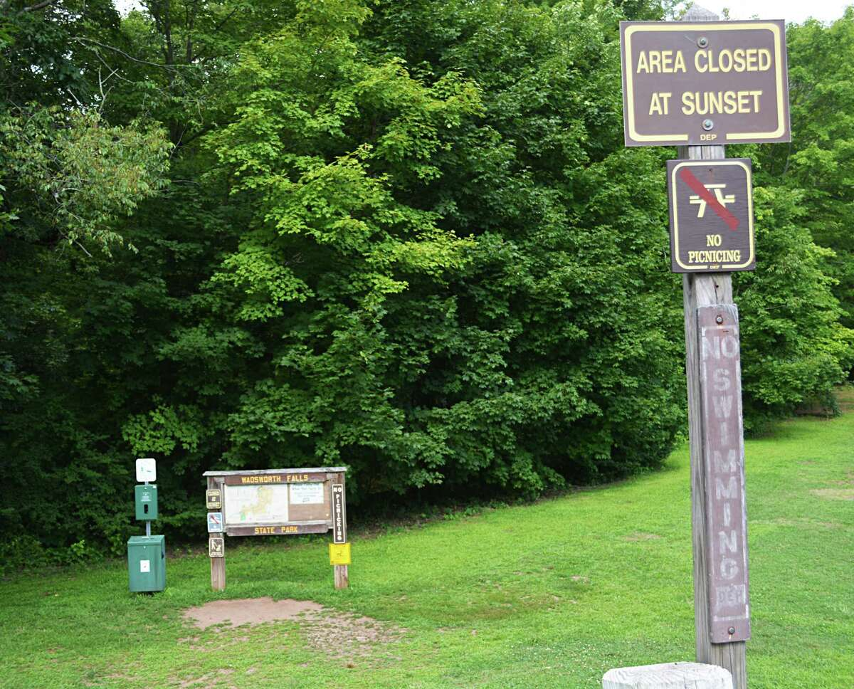 """Despite multiple """"no swimming"""" signs posted throughout the falls area of Wadsworth Falls State Park in Middlefield July 26, 2019, more than a dozen people could be seen swimming in the pool area, which presents a huge safety hazard and is against the law, local officials said."""