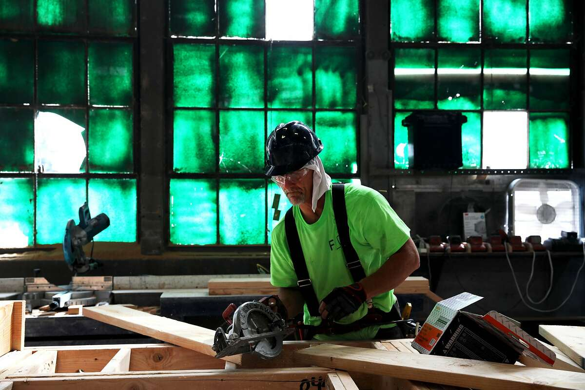 John Dryden, a carpenter and framer, works on corridor walls at the Factory_OS facility in Vallejo, Calif., on Friday, July 26, 2019. The company builds modular housing in the Bay Area.