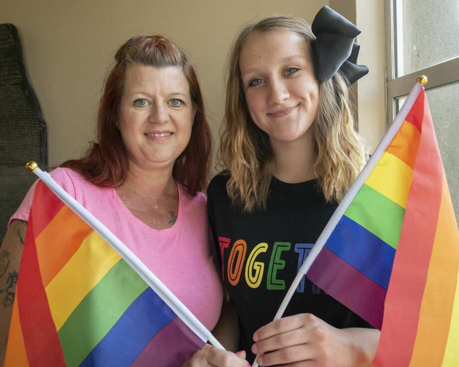 Shantel and Madeleine Mathis hold Pride flags after a Basin Pride organizers meeting on Tuesday, July 23, 2019 at Unitarian Universalist Church of Midland. Photo: Jacy Lewis/191 News