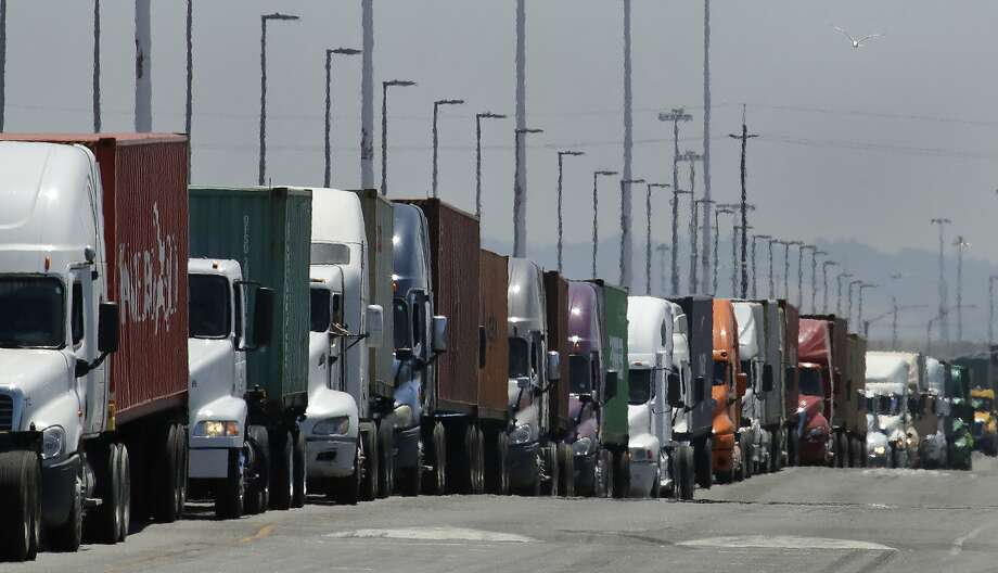 In this photo from Monday, July 22, 2019, trucks hauling shipping containers wait to unload at the Port of Oakland in Oakland, Calif. (AP Photo/Ben Margot) Photo: Ben Margot, Associated Press