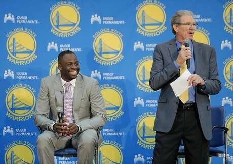Draymond Green (left) is introduced by Warriors analyst Jim Barnett at a press conference held to announce the re-signing of Green at the Warriors team practice facility in Oakland, California, on Thursday, July 9, 2015. Green was signed out of free agency to a multi-year contract. Per team policy, terms of the agreement were not announced.
