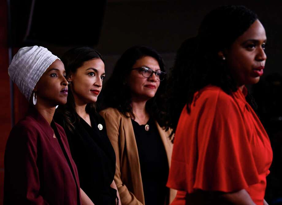 "Rep. Ayanna Pressley (D-MA), Rep. Ilhan Abdullahi Omar (D-MN), Rep. Rashida Tlaib (D-MI), and Rep. Alexandria Ocasio-Cortez (D-NY). A reader defends the women (dubbed ""The Squad""), saying they are corageous for speaking up against the president. Photo: BRENDAN SMIALOWSKI /AFP /Getty Images / AFP or licensors"