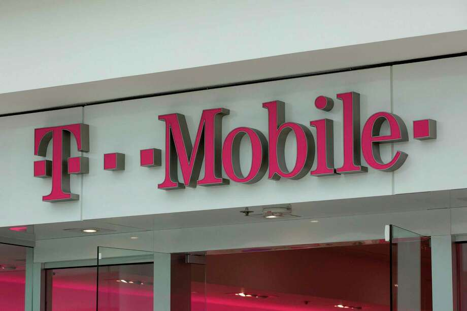 The T-Mobile logo is seen outside a shop in Washington, DC, on July 26, 2019. - US antitrust authorities approved the USD 26 billion merger of T-Mobile and Sprint in a deal that brings together the third- and fourth-largest wireless operators as the industry moves toward deployment of superfast 5G networks. (Photo by Alastair Pike / AFP)ALASTAIR PIKE/AFP/Getty Images Photo: ALASTAIR PIKE, Contributor / AFP/Getty Images / AFP or licensors
