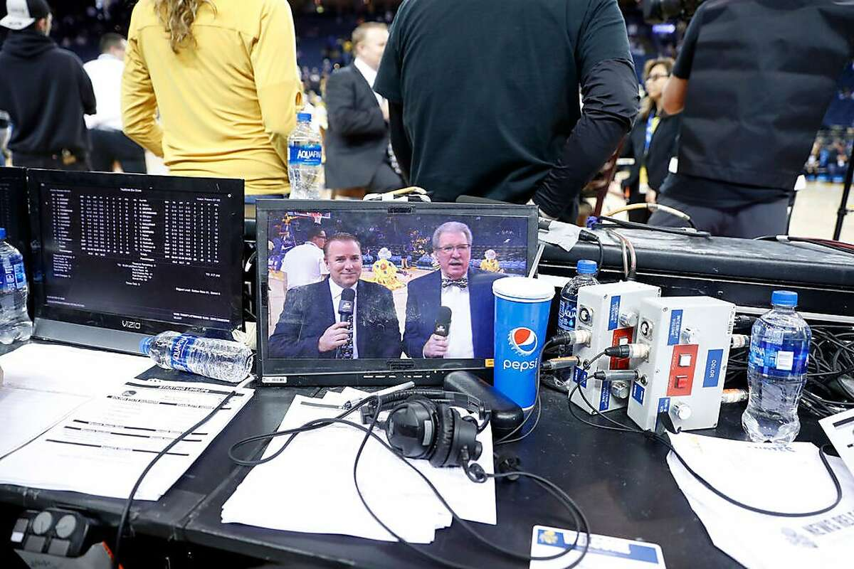 Golden State Warriors television broadcast announcers Bob Fitzgerald and Jim Barnett at Oracle Arena in Oakland, Calif., on Sunday, March 31, 2019.