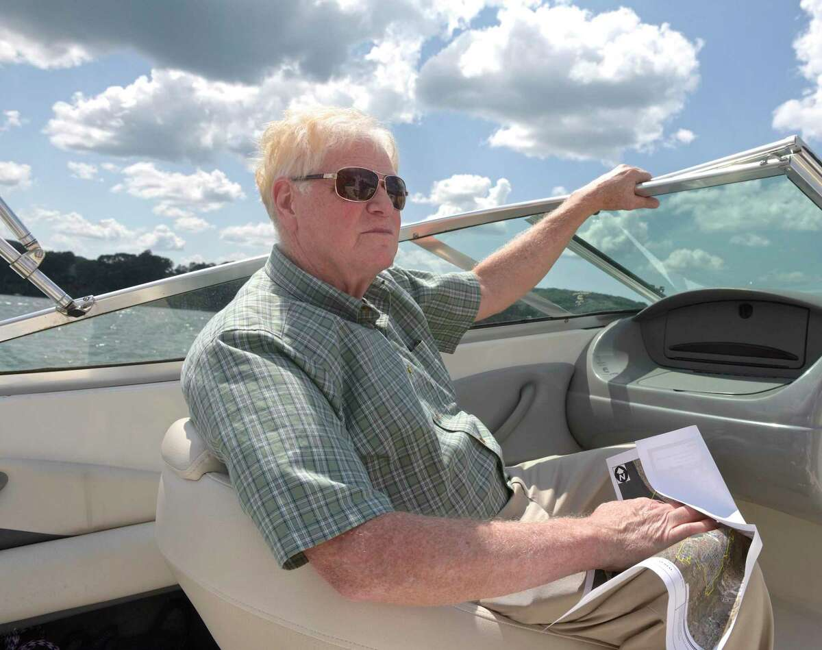 Nelson Malwitz, Chair of the Water Pollution and Control Authority looks at housing on Candlewood Lake in Brookfield. The town has received two grants one of which is to study septic discharges onto Candlewood Lake. Wednesday, July 24, 2019, in Brookfield, Conn.