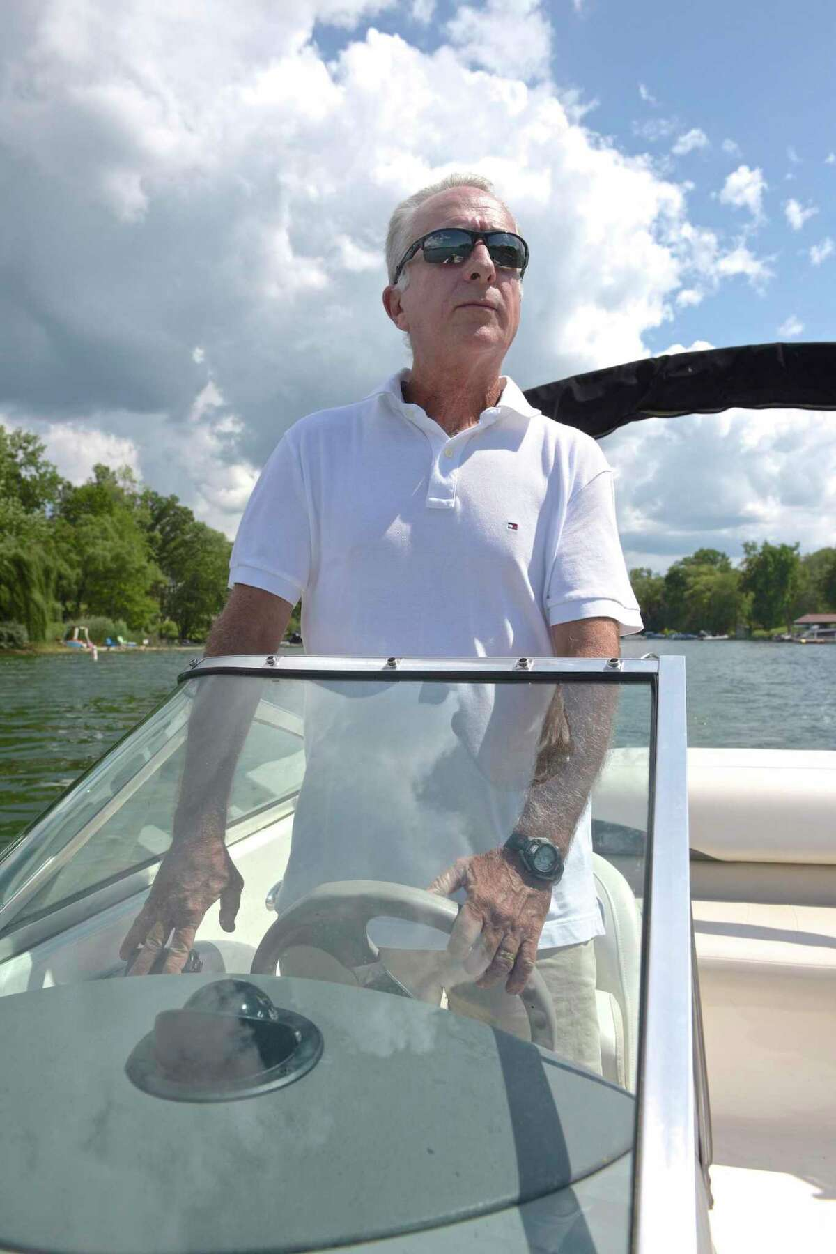 Jim Murray, a board member of the Water Pollution and Control Authority looks at housing on Candlewood Lake in Brookfield. The town has received two grants one of which is to study septic discharges onto Candlewood Lake. Wednesday, July 24, 2019, in Brookfield, Conn.