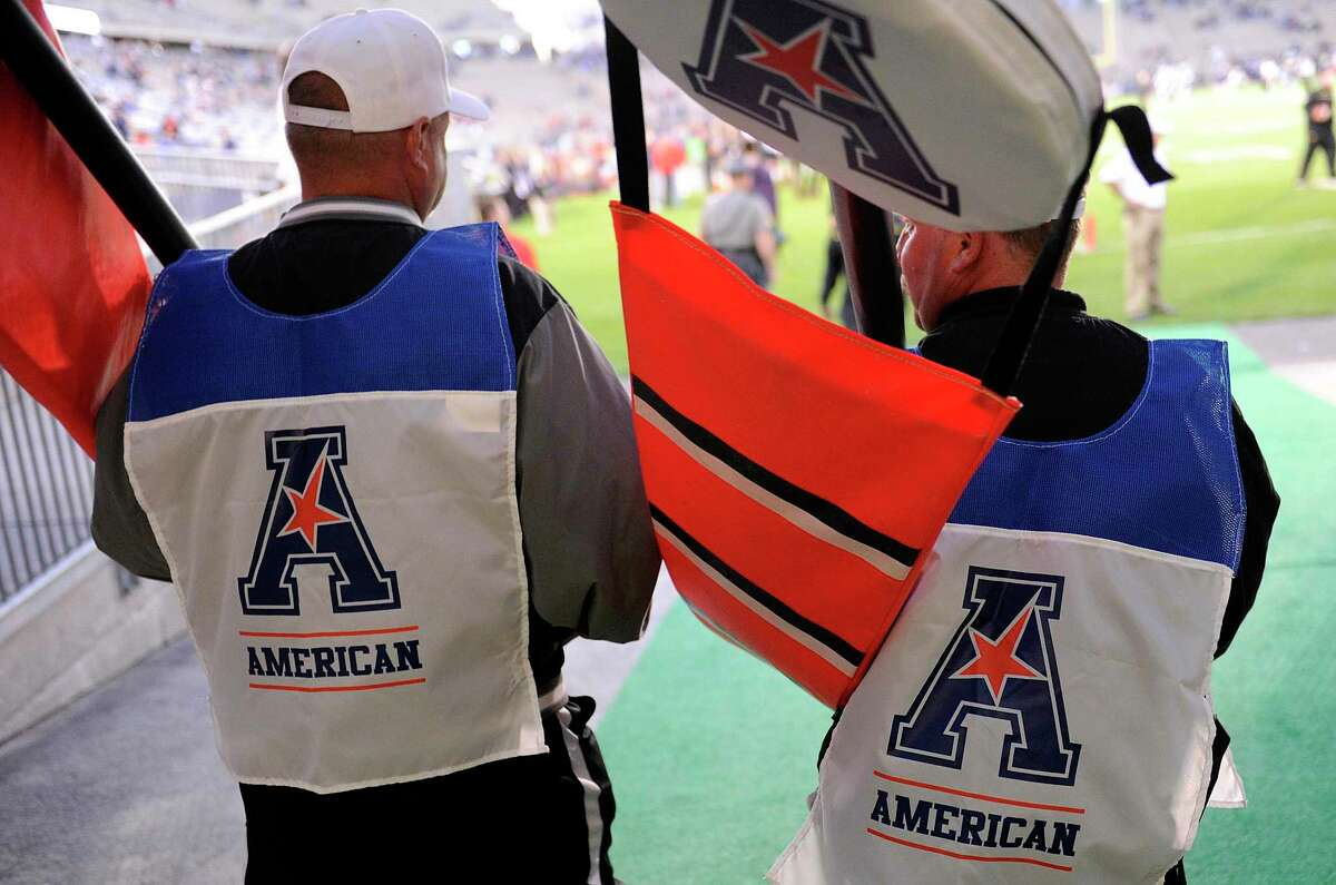 EAST HARTFORD, CT - SEPTEMBER 14: Members of the chain gang walk onto the field wearing the logo of the American Athletic Conference before the game between the Connecticut Huskies and the Maryland Terrapins at Rentschler Field on September 14, 2013 in East Hartford, Connecticut. (Photo by G Fiume/Maryland Terrapins/Getty Images)