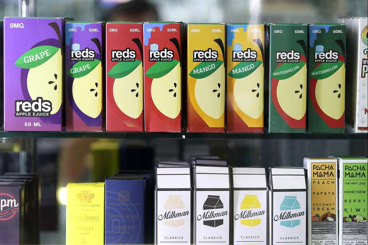 SAN FRANCISCO, CALIFORNIA - JUNE 25: E-juice, used in e-cigarette vaporizers, is displayed at Smoke and Gift Shop on June 25, 2019 in San Francisco, California. The San Francisco Board of Supervisors voted unanimously, 11-0, to be the first city in the Un