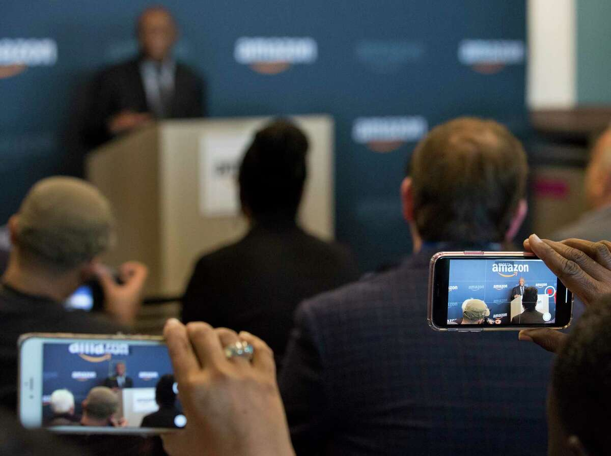 People record Houston Mayor Sylvester Turner delivering his speech to welcome Amazon Web Services during a press conference on Friday, July 26, 2019, in Houston. Houston is one of Amazon's 18 Tech Hubs in the U.S.