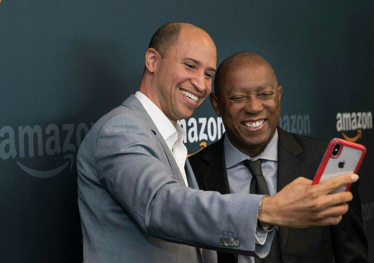 """Kris Satterthwaite, left, Enterprise Sales Leader for Amazon Web Services (AWS), takes a selfie with Houston Mayor Sylvester Turner and after a grand opening press conference on Friday, July 26, 2019, in Houston. Houston is one of Amazon's 18 Tech Hubs around the U.S., and Turner called Houston """"silicon bayou."""""""
