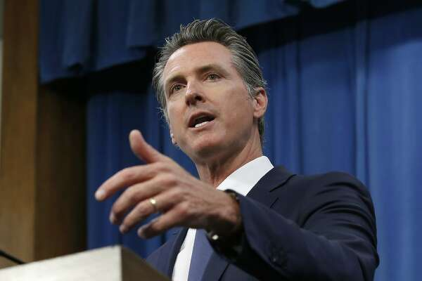 Gov. Gavin Newsom discusses a report detailing the efforts by the DMV to improve customer services during a news conference in Sacramento, Calif., Tuesday, July 23, 2019. Some of the suggestions are to accept credit cards, upgrade the DMV's website and offer clearer instructions on how to obtain a new federally mandated ID. (AP Photo/Rich Pedroncelli)