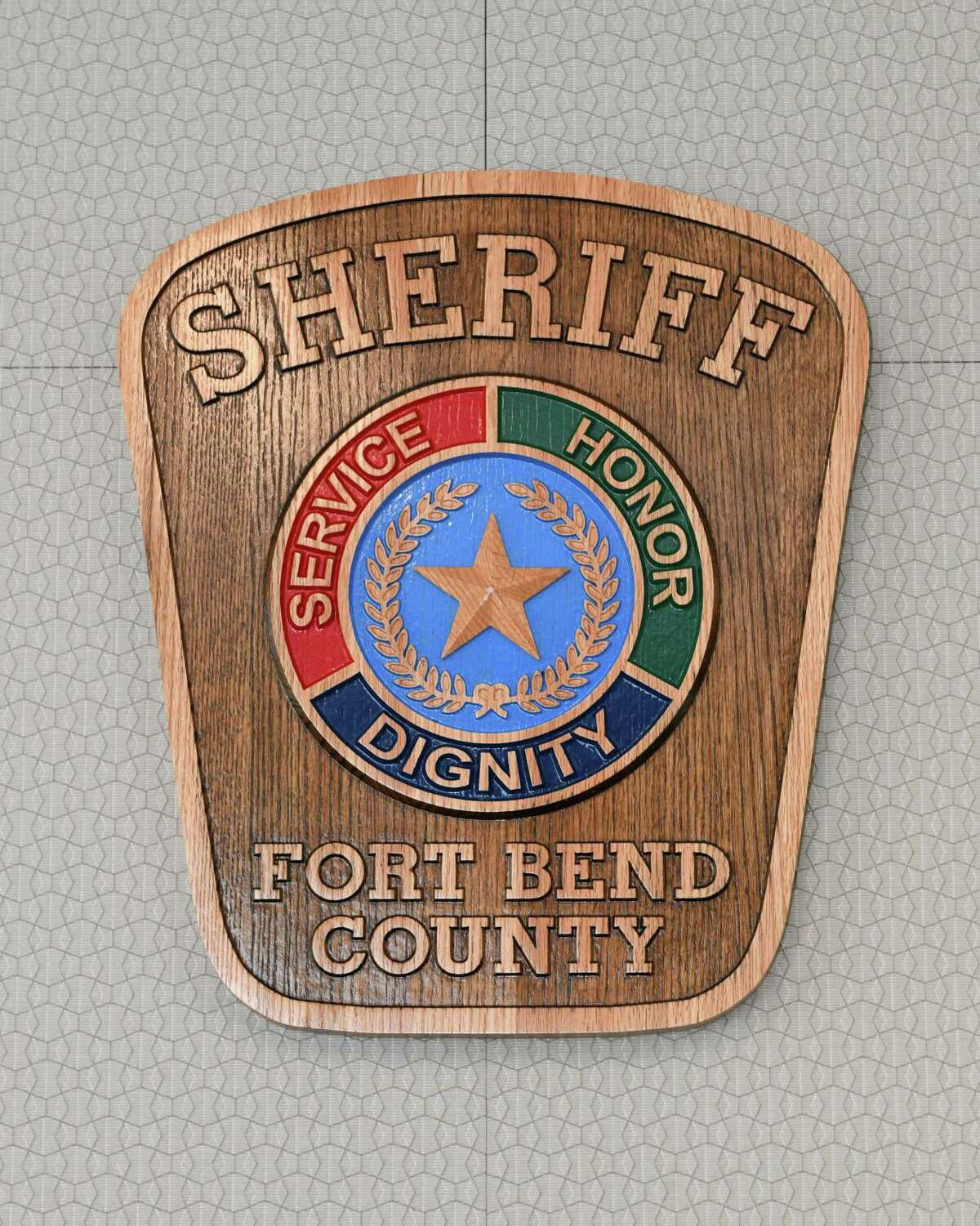 A plaques made by inmates at the Texas Department of Corrections adorn the walls at the Fort Bend County Sheriff's office in Richmond, TX on Saturday, July 20, 2019.