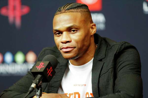 Russell Westbrook talks to the media at a Houston Rockets press conference introducing him at the Toyota Center on Friday, July 26, 2019 in Houston.