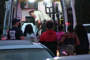 Emergency officials tend to a gunshot child in the back of an ambulance in Orange late Monday evening.  Photo provided by Eric Williams