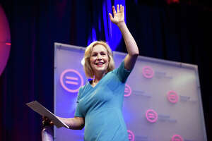 Sen. Kirsten Gillibrand (D-N.Y.), a Democratic presidential candidate, leaves the stage after addressing the National Urban League Conference in Indianapolis on Friday, July 26, 2019. Gillibrand on Thursday accused some of her fellow Democratic candidates of not supporting women who work outside the home, her most pointed attempt yet to frame her struggling candidacy as the best option for women voters. (Mark Felix/The New York Times)