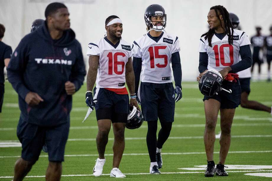 PHOTOS: Texans vs. Jaguars Andre Johnson, far left, jogs up the field past Houston Texans wide receivers Keke Coutee (16), Will Fuller (15) and DeAndre Hopkins (10) walk up the field together during training camp at the Methodist Training Center on Friday, July 26, 2019, in Houston. >>>See more photos from the Texans' first win of the season ... Photo: Brett Coomer, Houston Chronicle / Staff Photographer / © 2019 Houston Chronicle