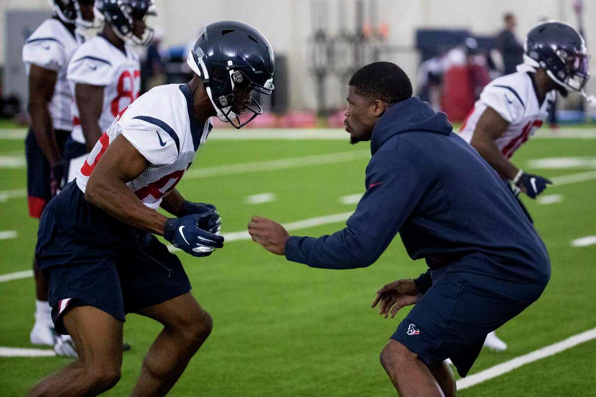 Houston Texans wide receiver Jester Weah (86) works with Andre Johnson, special assistant to the head coach, during training camp at the Methodist Training Center on Friday, July 26, 2019, in Houston.