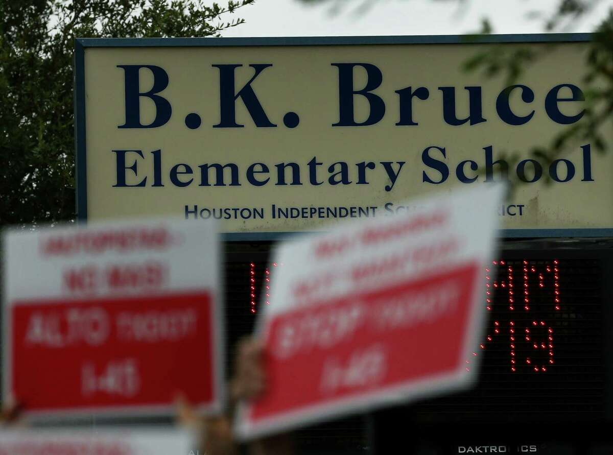 Fifth Ward residents and community advocates held a press conference outside Bruce Elementary School to urge Houston-Galveston Area Council's Transportation Policy Council to delay voting on committing $100 million to a $1.2 billion widening of Interstate 45 on July 23.