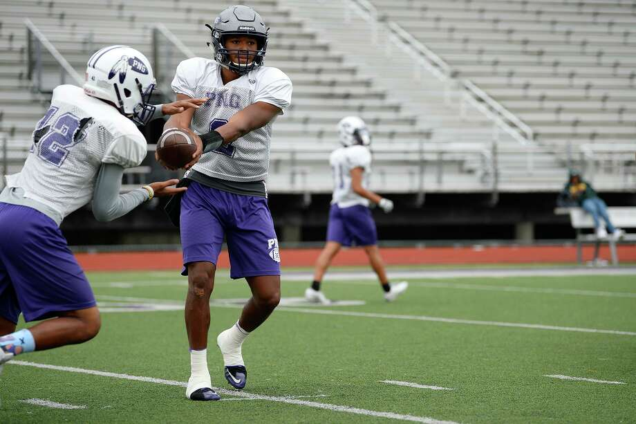 Port Neches-Groves quarterback Roschon Johnson hands the ball off during practice on Thursday. Johnson, who is committed to play at the University of Texas, is the school's all-time passing record.   Photo taken Thursday 10/25/18  Ryan Pelham/The Enterprise Photo: Ryan Pelham / The Enterprise / ©2018 The Beaumont Enterprise