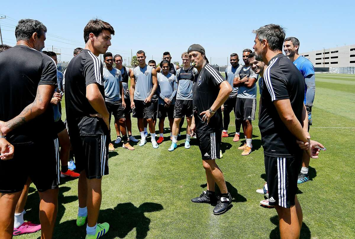 San Jose Earthquakes head coach Matias Almeyda, right, talks with team at the end practice at the Ayala Stadium practice field in San Jose, Calif., on July 26, 2019.