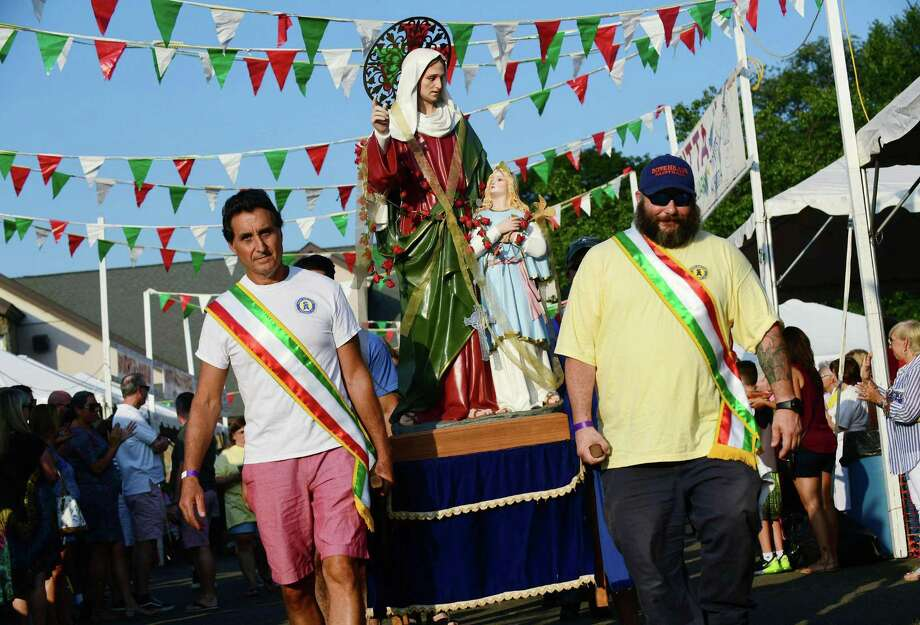 Vincent Scicchitano and Sal Covella help carry the statue of St. Ann as local residents enjoy the 90th year of the St. Ann's Feast Friday, July 26, 2019, at the St. Ann's Club on Hendricks Avenue in Norwalk. Conn. The Club was established 105 years ago to celebrate italian hertiage. The festival raises close to $50,000 very year for local charities and attracts thousands of visitors. Photo: Erik Trautmann / Hearst Connecticut Media / Norwalk Hour