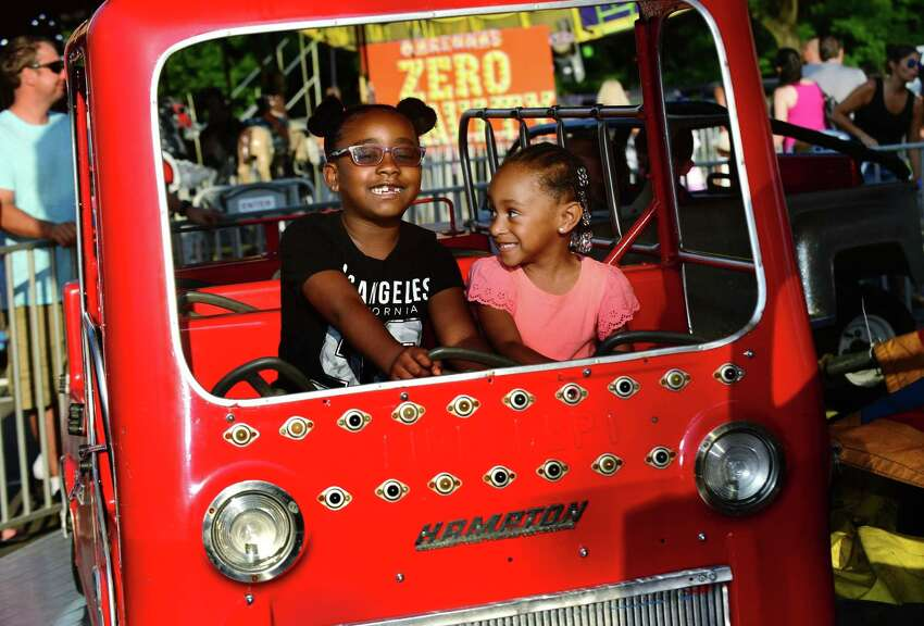 Norwalk residents including Serah Daniels, 6, and Lenni Abraham, 3, enjoy rides at the 90th year of the St. Ann's Feast Friday, July 26, 2019, at the St. Ann's Club on Hendricks Avenue in Norwalk. Conn. The Club was established 105 years ago to celebrate italian hertiage. The festival raises close to $50,000 very year for local charities and attracts thousands of visitors.