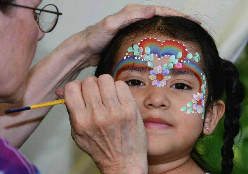 Sonia Mendieta, 3, gets her face painted at the 90th year of the St. Ann's Feast Friday, July 26, 2019, at the St. Ann's Club on Hendricks Avenue in Norwalk. Conn. The Club was established 105 years ago to celebrate italian hertiage. The festival raises close to $50,000 very year for local charities and attracts thousands of visitors.