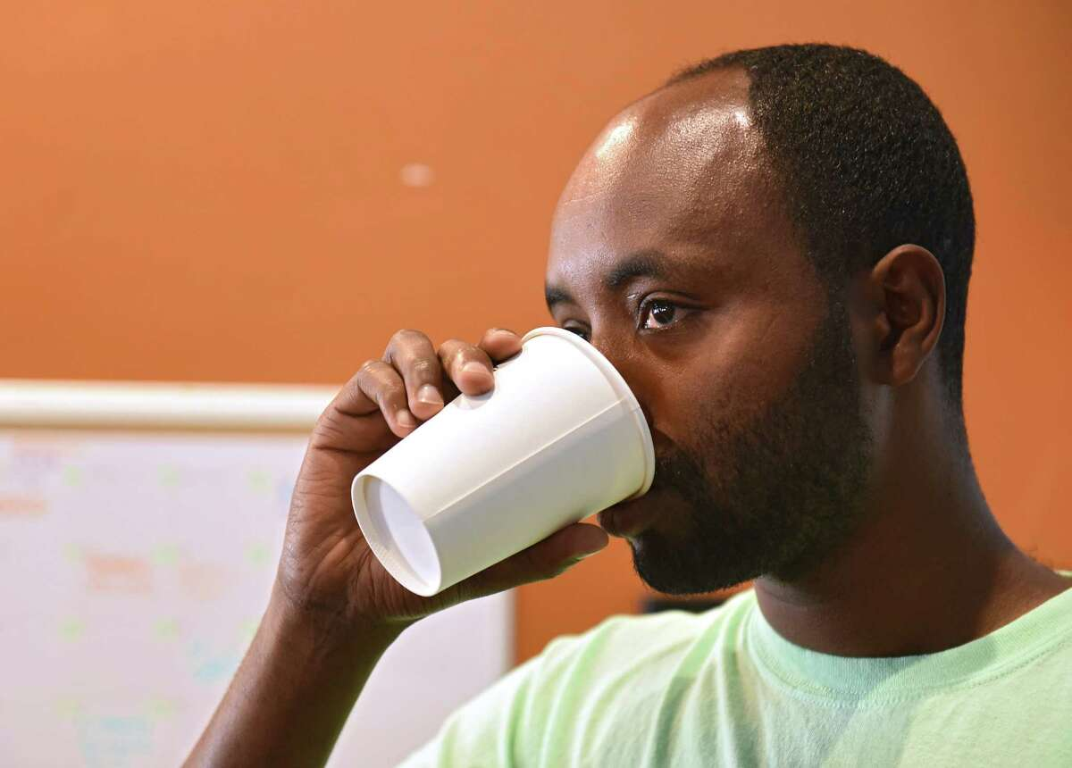 Belayneh Woldemariam of Ethiopia samples various coffees as Empower Ethiopian hosts a conversation and cultural exchange at Happy Cappuccino on Friday, July 26, 2019 in Schenectady, N.Y. The shop, which is located on Jay St., donated $1 from every coffee purchased during the fundraiser to Empower Ethopia. (Lori Van Buren/Times Union)