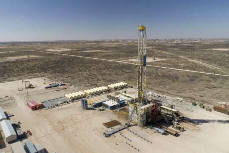 A Nabors Industries drill rig stands over an oil well for Chevron in the Permian Basin.