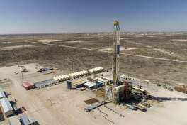 A Nabors Industries drill rig stands over an oil well for Chevron in the Permian Basin in Midland, Texas on March 1, 2018. MUST CREDIT: Bloomberg photo by Daniel Acker.