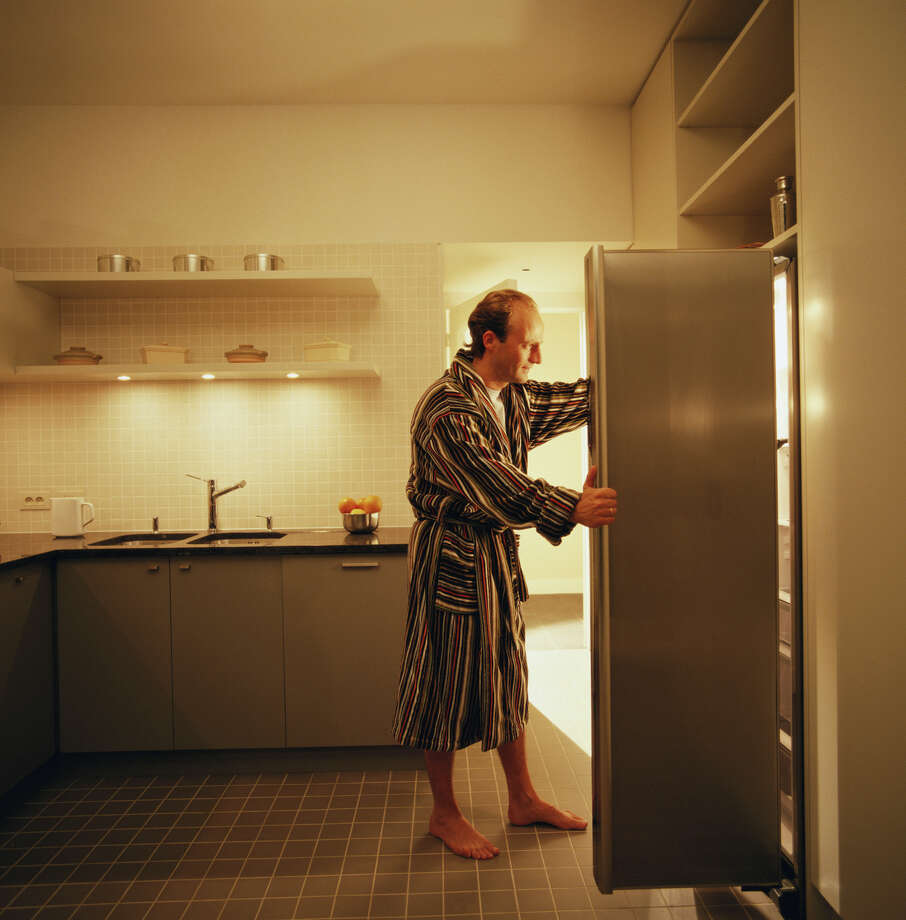 File photo of a man looking into his refrigerator. Photo: Ghislain & Marie David De Lossy/Getty Images