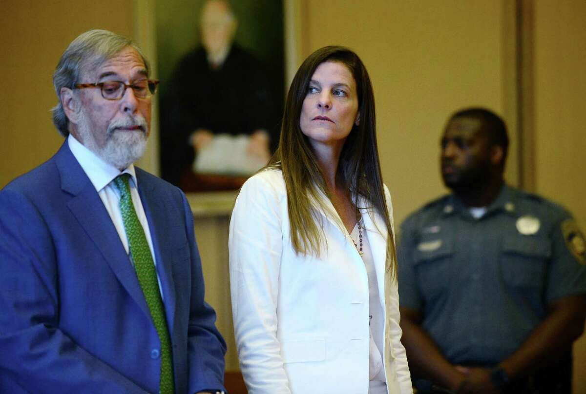 FILE: Michelle Troconis and her legal team including Andrew Bowman, left, arrange their next court date in her appearance for tampering with evidence and hindering the investigation into the disappearance of Jennifer Dulos at Stamford Superior Court Thursday, July 18, 2019 in Stamford, Conn.
