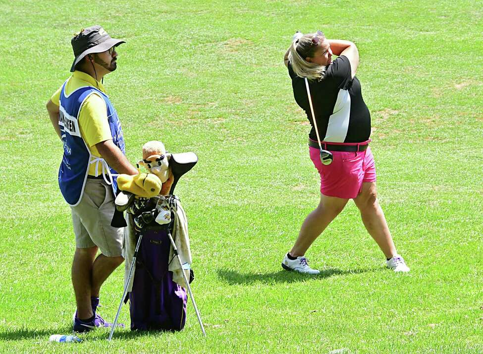 UAlbany women's golf coach Colleen Cashman-McSween hits a fairway shot on the first hole during the first round of the CDPHP Open, a 54-hole Symetra Tour at Capital Hills Golf Course on Friday, July 26, 2019 in Albany, N.Y. (Lori Van Buren/Times Union)