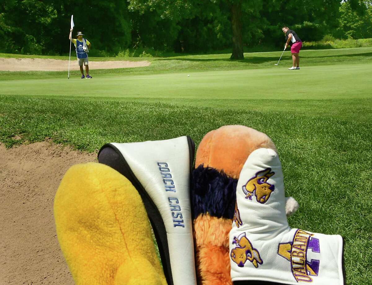 UAlbany women's golf coach Colleen Cashman-McSween putts on the third hole as her caddie Matt Ragovin holds the flag during the first round of the CDPHP Open, a 54-hole Symetra Tour at Capital Hills Golf Course on Friday, July 26, 2019 in Albany, N.Y. (Lori Van Buren/Times Union)