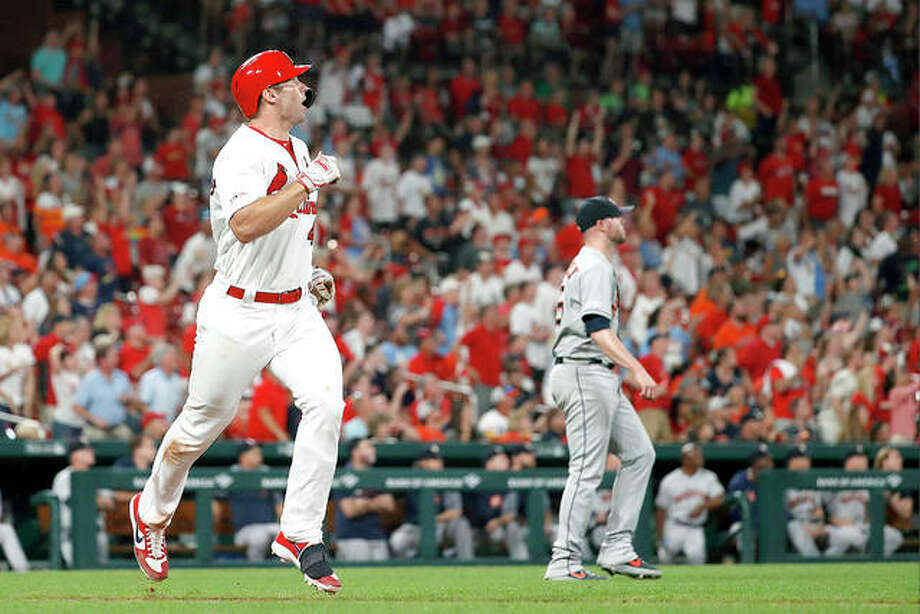 The Cardinals' Paul Goldschmidt, left, and Houston Astros relief pitcher Ryan Pressly watch Goldschmidt's three-run home run in the eighth inning of Friday night's game in St. Louis. The Cardinals won 5-3. Photo: Jeff Roberson | AP Photo