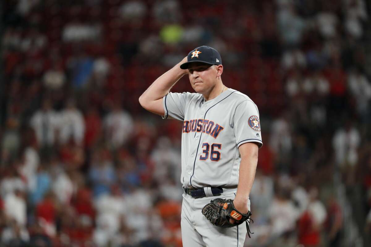 Houston Astros relief pitcher Will Harris pauses after giving up a solo home run to St. Louis Cardinals' Matt Wieters during the seventh inning of a baseball game Friday, July 26, 2019, in St. Louis. (AP Photo/Jeff Roberson)