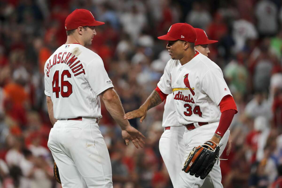 St. Louis Cardinals' Paul Goldschmidt (46) and Yairo Munoz celebrate following a victory over the Houston Astros in a baseball game Friday, July 26, 2019, in St. Louis. (AP Photo/Jeff Roberson)