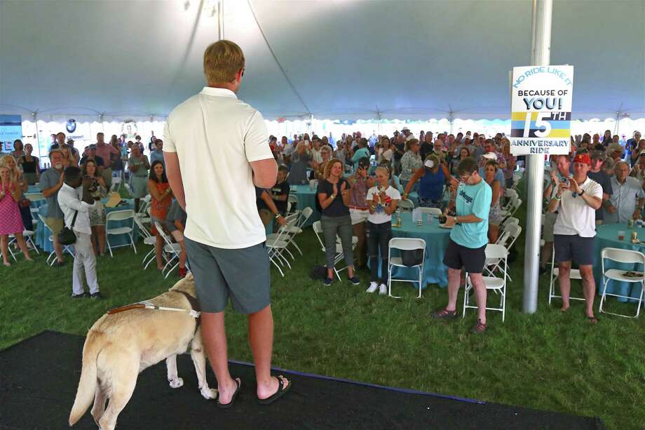 Jake Olson gets a standing ovation at the 15th annual CT Challenge opening ceremony at the Fairfield County Hunt Club on Friday, July 26, 2019, in Westport, Conn. Photo: Jarret Liotta / Jarret Liotta / ©Jarret Liotta