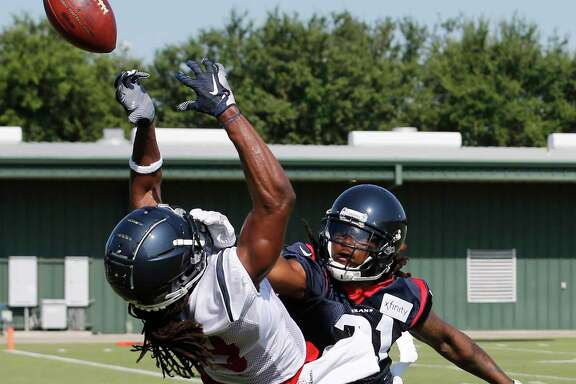 Houston Texans cornerback Bradley Roby (21) breaks up a pass intended for wide receiver Isaac Whitney (19) during training camp at the Methodist Training Center on Thursday, July 25, 2019, in Houston.