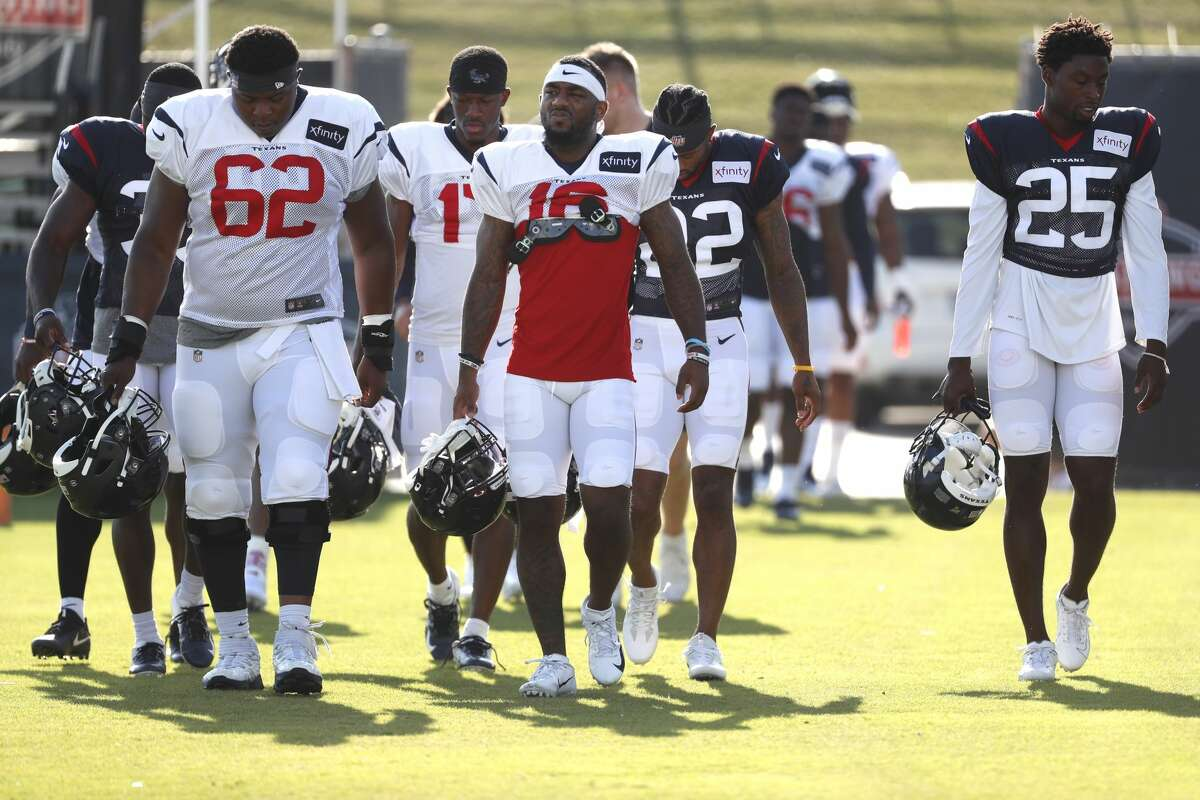 Houston Texans players walk onto the practice field during training camp at the Methodist Training Center on Saturday, July 27, 2019, in Houston.