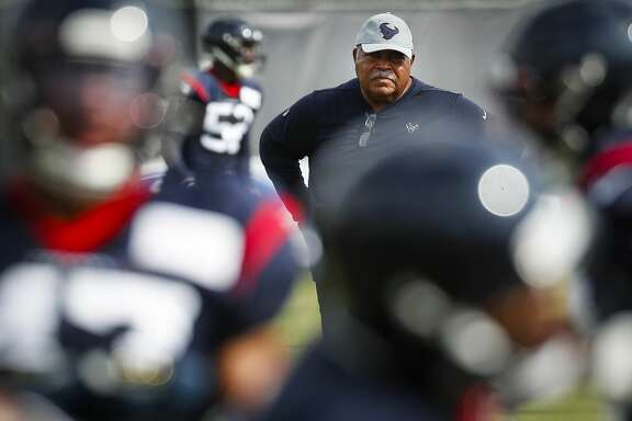 Houston Texans defensive coordinator Romeo Crennel watches his players work out during training camp at the Methodist Training Center on Saturday, July 27, 2019, in Houston.