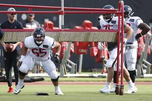 Houston Texans offensive guard Greg Mancz (65) burst out of his stance during a drill during training camp at the Methodist Training Center on Saturday, July 27, 2019, in Houston.
