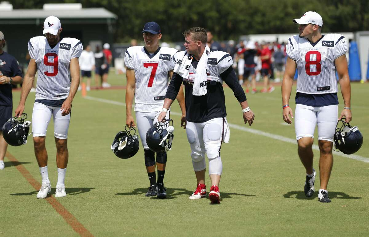 Houston Texans punter Bryan Anger (9), kicker Ka'imi Fairbairn (7), long snapper Jon Weeks (46), and punter Trevor Daniel (8) walk across the field at the end of practice during training camp at the Methodist Training Center on Saturday, July 27, 2019, in Houston.