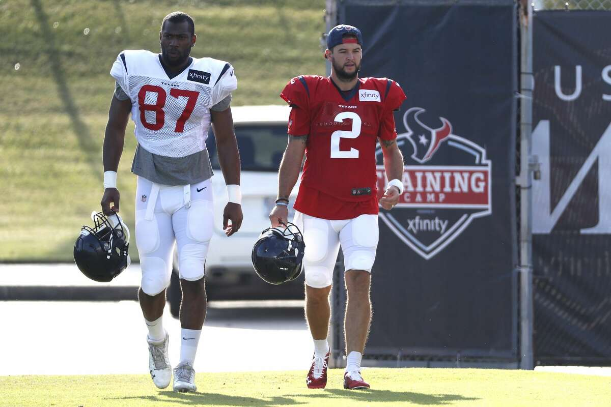 Houston Texans tight end Darren Fells (87) and quarterback AJ McCarron (2) walk onto the practice field during training camp at the Methodist Training Center on Saturday, July 27, 2019, in Houston.