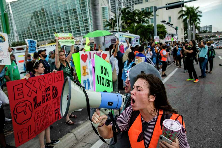 FILE-- Climate activists march to the Adrienne Arsht Center for the Performing Arts, site of the Democratic presidential debate, in Miami, June 27, 2019. Even if Democrats win the White House and the Senate in 2020, effectively combating climate change might require the elimination of the Senate filibuster. (Scott McIntyre/The New York Times) Photo: SCOTT MCINTYRE / Scott Montyre / New York Times / NYTNS
